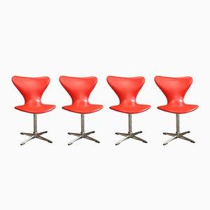 Orangefarbene Drehstühle, 1960er, 4er Set