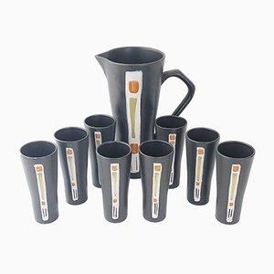 Jarra para zumo de naranja francesa de cerámica negra y 8 vasos, años 50