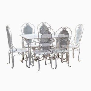 Juego de mesa y sillas, años 50