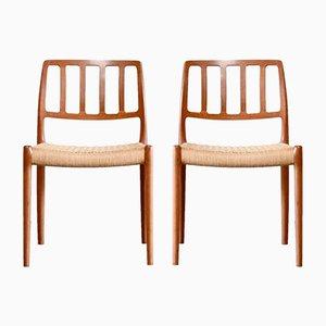 Teakholz und Geflecht Modell 83 Esszimmerstühle von N. O. Møller für J. L. Møllers, 2er Set