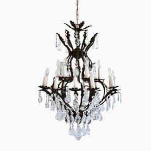 Lámpara de araña antigua grande en forma de jaula de metal fundido