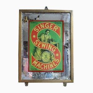 Espejo antiguo con señal publicitaria de Singer