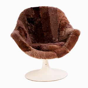 Silla giratoria con tapicería de piel de oveja, años 60
