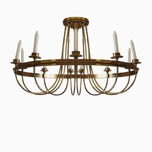 Lámpara de araña antigua de latón bañado en oro