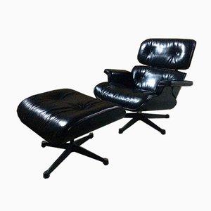 Schwarzer Modell 670 Ledersessel & Modell 671 Fußhocker aus Esche von Charles & Ray Eames für Vitra, 2008