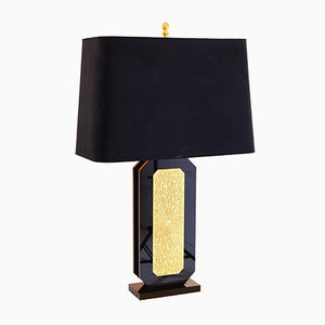 Lámpara de mesa de lucite negro y latón tallado de Lova Création, años 80