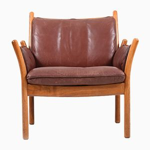 Vintage Model Genius Rosewood Lounge Chair by Illum Wikkelso for CFC Silkeborg