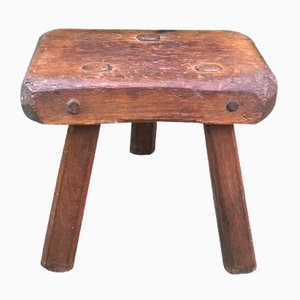 Taburete trípode brutalista de madera maciza, años 50