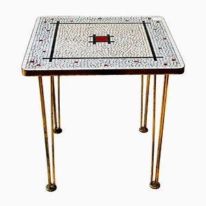 Mesa de centro de vidrio en mosaico con patas de latón, años 60