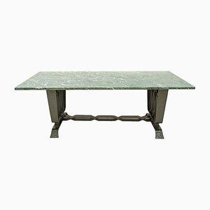 Tavolo in travertino e ferro battuto di Pier Luigi Colli, anni '20