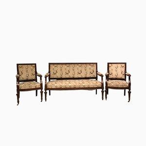 Set da salotto antico di un divano e due poltrone