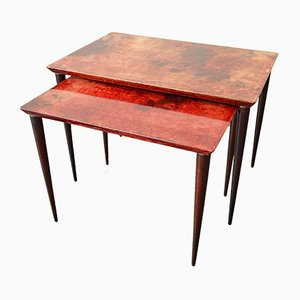 Mesas nido de cuero rojo de Aldo Tura para Tura Mobili, años 60
