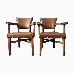 Vintage Armlehnstühle aus braunem Leder & Holz mit Nieten, 2er Set