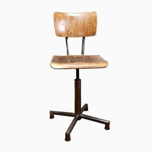 Silla giratoria de médico vintage de madera