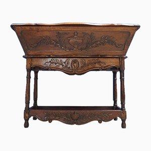 Mobiletto antico Luigi XV in legno di noce intagliato, Francia