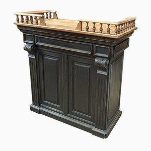 Bancone antico nero con mensole e cassetti