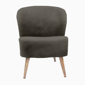Customizable Vintage Lounge Chair with a Rounded Back