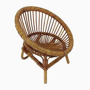 Runder Vintage Kinder-Armlehnstuhl aus Rattan