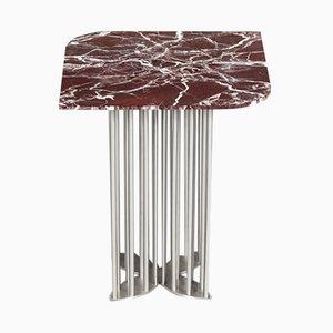 Tavolino Naiad in marmo rosso ed acciaio di Naz Yologlu per NAAZ