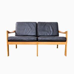 Sofa aus Eiche mit Lederkissen von Illum Wikkelsø für Niels Eilersen, 1960er