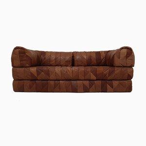 Sofá cama vintage de retazos de cuero coñac, años 70