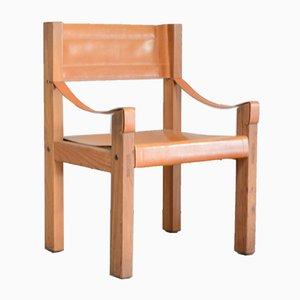 Silla vintage con asiento de cuero coñac de Pierre Chapo