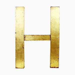 Cartel de la letra H vintage de metal dorado