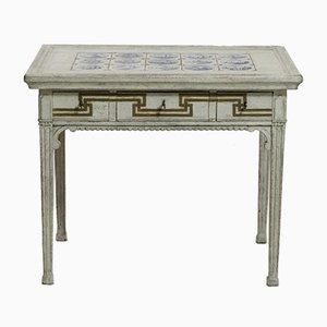 Mesa antigua tallada dorada con tablero de azulejos