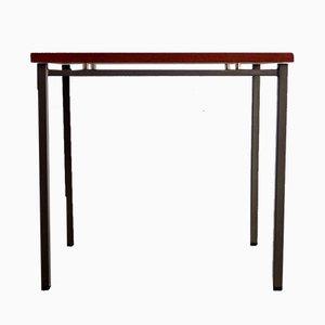 Mesa auxiliar minimalista con tablero de teca y base de metal, años 70