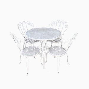 Silla de jardín y cuatro sillas, años 40
