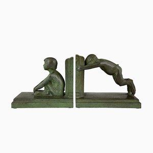 Fermalibri Art Deco in bronzo a forma di bambino e bambina di Paul Silvestre per Susse Freres, anni '20, set di 2