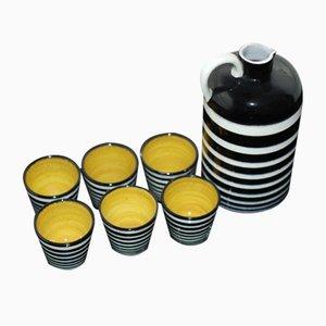 Bottiglia e bicchieri vintage in ceramica
