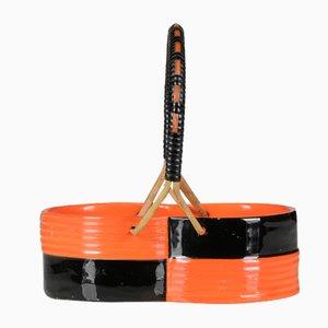 Centrotavola a forma di cesto in ceramica nera e arancione con manico in vimini di Rometti Umbertide, Italia, anni 60'