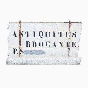 Letrero de tienda de antigüedades francés vintage