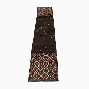 Alfombra Verneh hecha con una antigua alforja de tejido plano