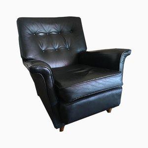 Sillón vintage de cuero negro de Artifort, años 60