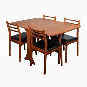 Mesa abatible Mid-Century de teca con cuatro sillas de Ib Kofod-Larsen para G Plan