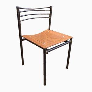 Sedia vintage in metallo e legno