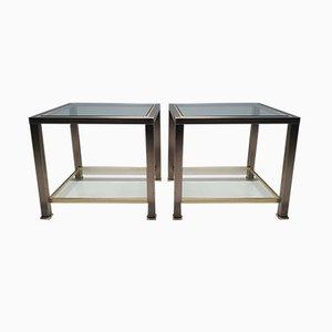 Mesas auxiliares vintage de vidrio y latón de Belgo Chrom, años 80. Juego de 2