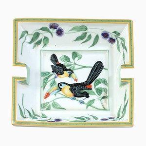 Cenicero de porcelana con tucán de Hermès, años 80