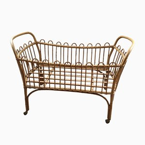 Vintage Rattan Crib on Wheels