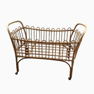 Vintage Rattan Crib on Wheels