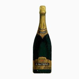 Insegna pubblicitaria antica a forma di bottiglia di champagne
