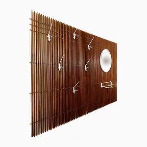 Unidad de pared grande de listones de madera con espejo, estante de vidrio y seis ganchos, años 70