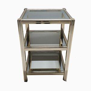 Mesa auxiliar de metal dorado y vidrio con tres niveles, años 80