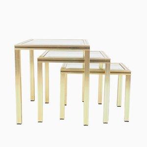 Mesas nido vintage de aluminio dorado con tablero de vidrio de Pierre Vandel