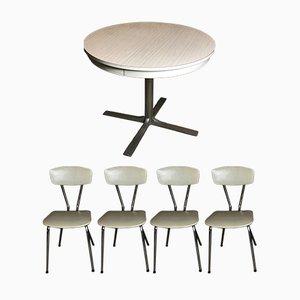Mesa redonda de formica con cuatro sillas, años 60