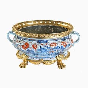 Vaso da fiori antico in bronzo dorato