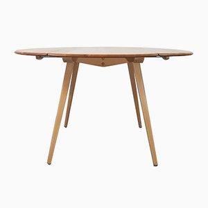Ausklappbarer Mid-Century Tisch von Lucian Ercolani für Ercol, 1960er