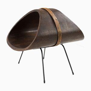 Revistero escultural de madera, años 50